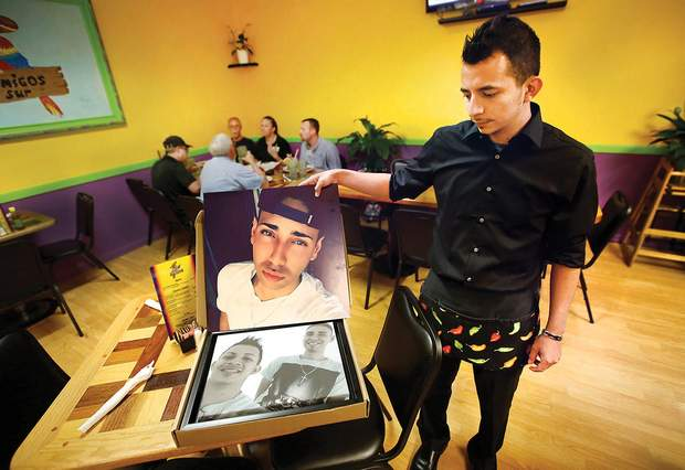 Tonny Del Solar talks about his late husband, Kevin Abeyta, on Friday at Los Amigos Del Sur, the restaurant they co-owned with two other people at the Main Mall. Abeyta died early Wednesday while saving a woman and her two children from a burning townhome.