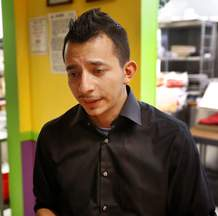 Tonny Del Solar grows emotional while talking about his late husband, Kevin Abeyta, on Friday at Los Amigos Del Sur, the restaurant they co-owned at the Main Mall. Del Solar said it was his dream to open a restaurant and Abeyta helped him achieve that goal.