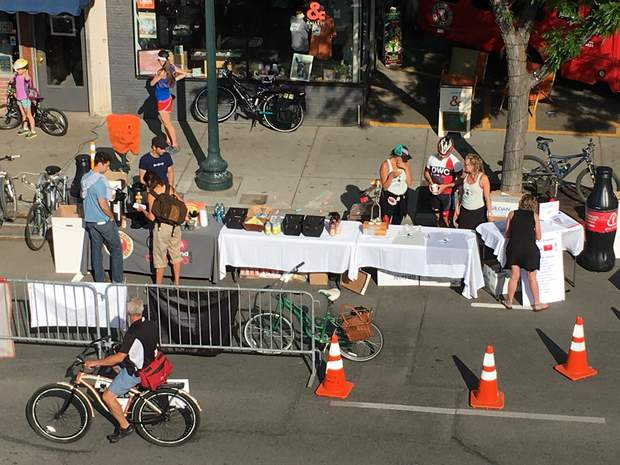 People who rode a bike, walked or carpooled were rewarded in June 2016 in the 1000 block of Main Avenue with free coffee, T-shirts, candy bars and energy bars as part of Bike to Work Day and Clean Commute Week in Durango.
