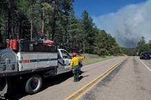 Al Waquie with the Jemez Ranger District on Thursday directs a truck towards the Cajete Fire in the Jemez Mountains in New Mexico.