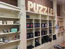 Joyful Nook Gallery, a puzzle shop featuring work of local artists, will open later this month. It will also sell stationary and calligraphy sets.