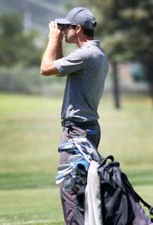 Jere Pelletier checks out the distance on the fairway on Saturday during the second round of the Navajo Trial Open at Hillcrest Golf Club.