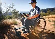 "Rosa Malloy-Post maneuvers the ""GRIT Freedom Chair,"" on Rim Trail on Thursday. The wheelchair designed to better navigate rough terrain was awarded to her for her outdoor pursuits."