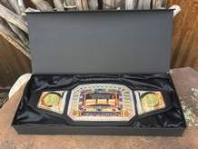 The overall winner of the Chili Chase Cook-off wins a heavy belt with a bejeweled gold buckle not unlike the kinds worn by pro wrestlers.