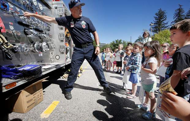 Scot Davis, with Durango Fire Protection District, describes how a fire engine works on Wednesday during the Durango Police Department and DFPD Police Car and Fire Truck Show and Tell, put on by the Durango Public Library.