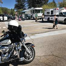 Children look over the Durango Police Department mobile command center and police cruisers and a motorcycle on Wednesday during the Durango Police Department and Durango Fire Protection District Police Car and Fire Truck Show and Tell, put on by the Durango Public Library.